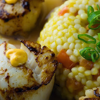 Blackened Scallops with Mango Tomato Couscous and Chili Aioli.