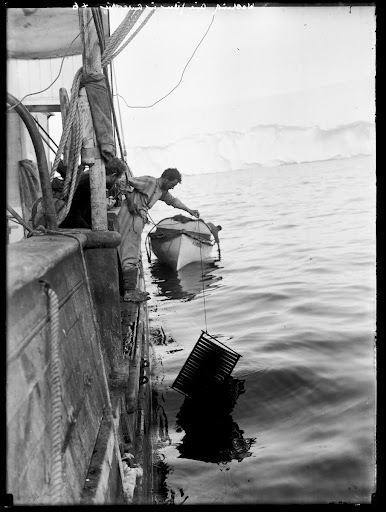 "Hurley washing cinematograph film after development in the Antarctic on board the ""Aurora"""