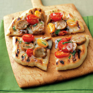 Pizza with Sausage, Tomatoes and Basil.