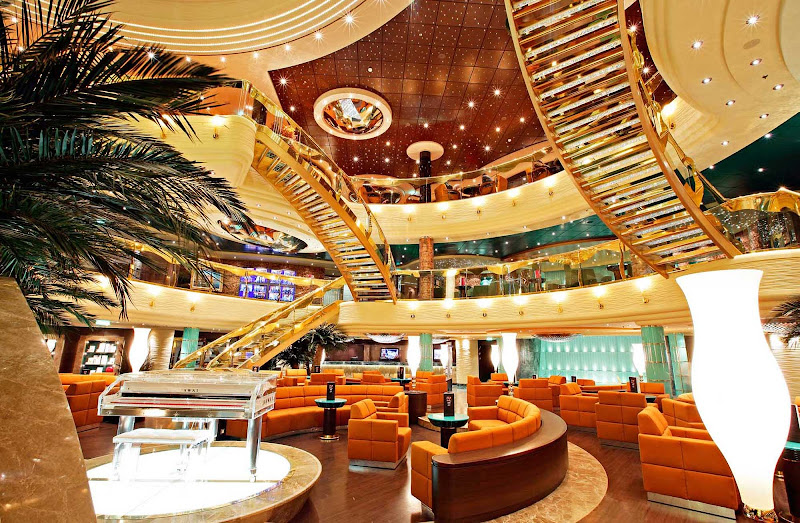 The soaring atrium of MSC Fantasia features staircases studded with Swarovski crystals.