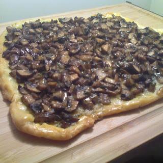 Mushroom Crostata with Roasted Garlic, Taleggio, and Thyme.