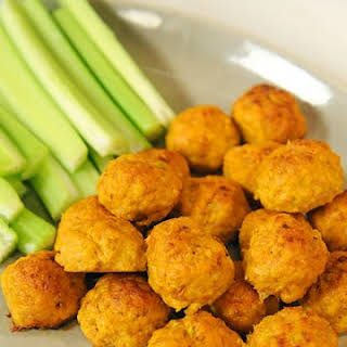 Mini Spicy Buffalo Chicken Balls with Blue Cheese and Hot Sauce.