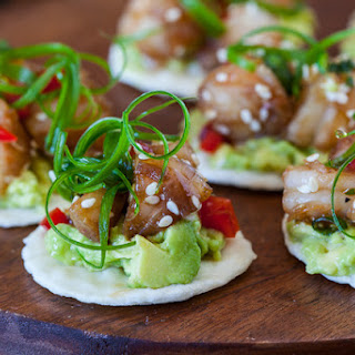 Wasabi Shrimp with Avocado on Rice Cracker.
