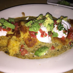 Sweet corn tamale cakes with avocado, creme fraiche, and salsa. Delicious!!