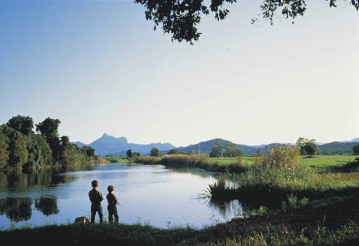 fishing_Tweed_River_Mt_Warning - Boys fish on the Tweed River as the peak of Mount Warning looms above them in Australia.