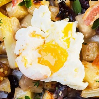 Roasted celeriac salad with red and green onions, chili optional. Bacon and poached egg on top.