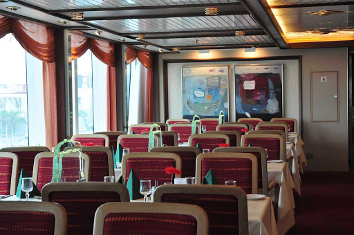Hurtigruten-Fram-dining - You'll enjoy the view of your travels and meet interesting new people as you dine aboard Hurtigruten's flagship, the ms Fram.
