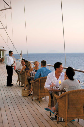 Windstar-Cruises-Candles-Grill-on-deck - Dine al fresco on deck and take in the passing scenery while dining at Candles Grill aboard your Windstar cruise.