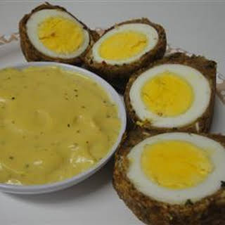 Scotch Eggs with Mustard Sauce.
