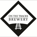 Logo for On The Tracks