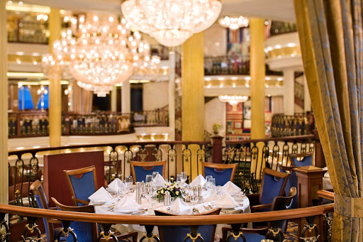 Independence-of-the-Seas-MacBeth-restaurant - The MacBeth dining room, on deck 4 of Independence of the Seas, offers guests a high-end dining experience for dinner. The ship's main dining room also has a Romeo and Juliet dining area on deck 3 and King Lear on deck 5.