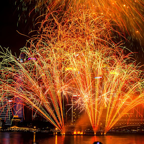 Fireworks by Jijo George - Abstract Fire & Fireworks ( orange, green, colors, variation, panoply, pyrotechnics, holidays and celebrations, smoke, firework display, holiday, red, sky, fourth of july, exploding, dark, summer, showing, july, night, celebration, light, black )