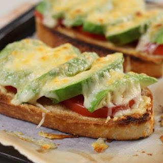 Cheesy Tomato And Avocado Toasts.
