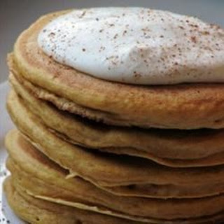 Pumpkin Pancakes with Nutmeg Whipped Cream.