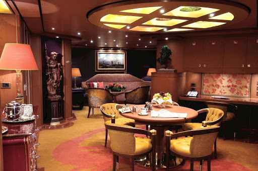 Holland-America-Vista-Class-Pinnacle-Suite-CatPS - The Pinnacle Suite (Penthouse Veranda Suite) aboard Holland America Line rewards you with about 1,296 square feet, including aprivate  veranda, kind bed, oversize whirlpool bath, living room, mini-bar, floor-to-celing windows, large-screen TV and concierge service.