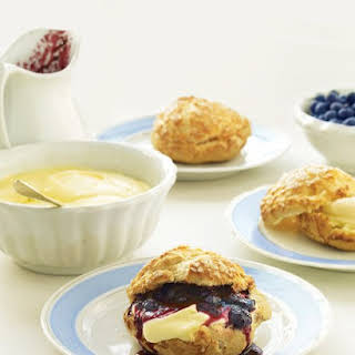 Cream Puffs with Lemon Mousse and Blueberry Sauce.