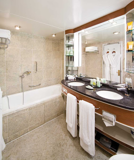 Silversea_Veranda_Suite_bathroom-1 - Press your toes against the fine marble in the Veranda Suite bathroom aboard Silver Whisper, equipped with a full size bath and separate tub.