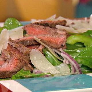 Rocket salad with steak, shaved Parmesan and lemon vinaigrette.