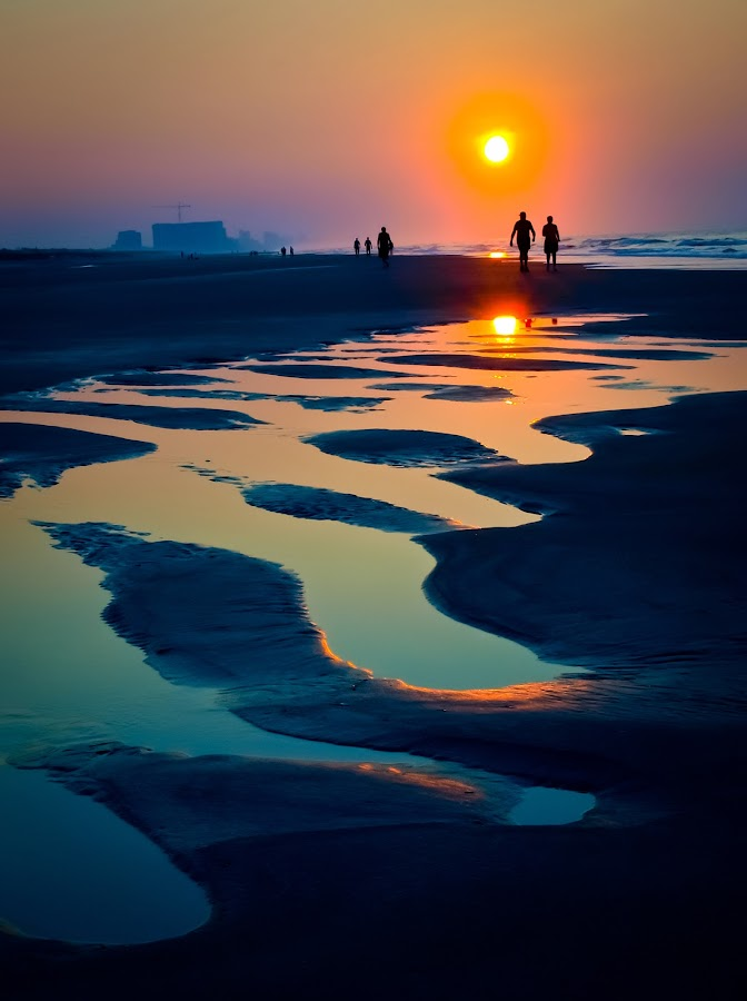Morning Stroll on the Beach by Ron Plasencia - Uncategorized All Uncategorized ( walking, nc, silouettes, dramatic, reflections, beach, sunrise, myrtle beach )