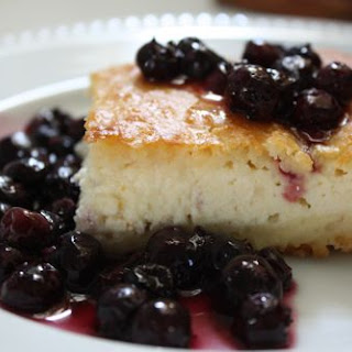Baked Blintz Cake with Fresh Blueberry Sauce.