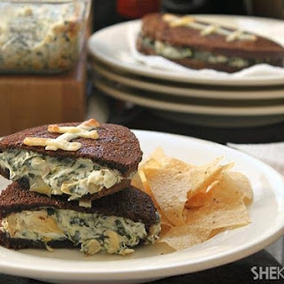 Football-shaped Grilled Cheese Sandwiches Stuffed With Spinach Artichoke Dip.