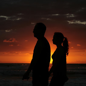 Romantics by Yana Villion - People Couples ( sunset, silhouette, romantics, sea, couple, beach, seascape, people, , golden hour, sunrise, improving mood, moods, red, love, the mood factory, inspirational, passion, passionate, enthusiasm )