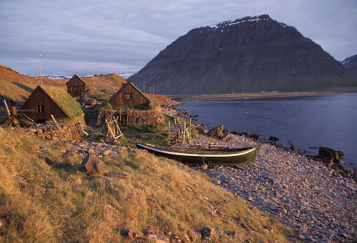 Turf houses along the rocky shores of Iceland.