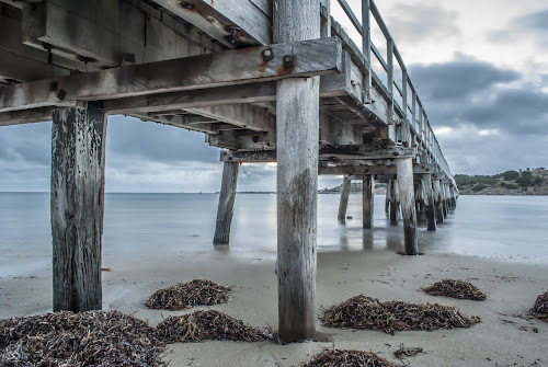 The Quiet by Sharon Wills - Buildings & Architecture Bridges & Suspended Structures ( water, sand, south australia, victor harbour, victor harbor, waves, beach, jetty,  )