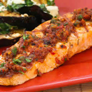 Grilled Salmon with Sun-Dried Tomato, Olive, Caper, and Parsley Relish.