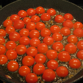 Seared Cherry Tomatoes with Spinach Pesto and Buccatini.