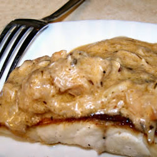 Broiled Grouper with Creamy Crab and Shrimp Sauce.