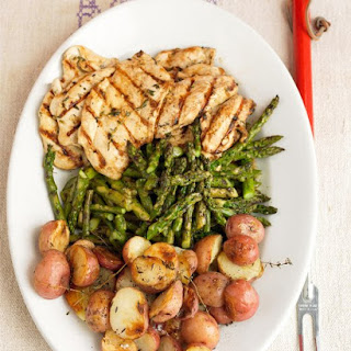 Garlic-Marinated Chicken Cutlets with Grilled Potatoes.