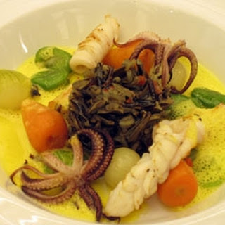 Squid With Wild Rice And Saffron Veloute.