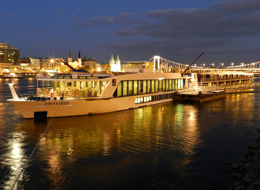 AmaVerde docked at night during a European river cruise. The this 161-passenger ship features twin balcony staterooms, a heated swimming pool, fitness center and a choice of dining venues.