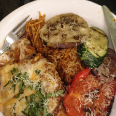 Chicken Parmesan with noodles and roasted vegetables.