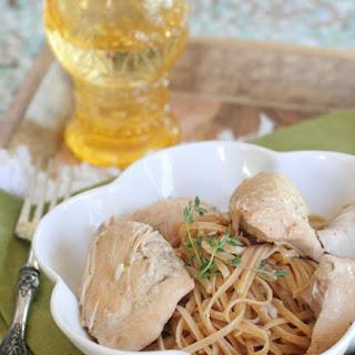 Slow Cooker Honey Dijon Chicken Over Garlic Pasta.