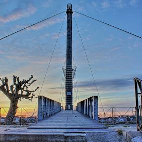 Climbing the foot bridge of Agen - France by Marcel de Groot - Buildings & Architecture Bridges & Suspended Structures ( orange, foot bridge, blue, agen, sundown, france )