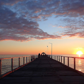 Sunset behind the jetty by Pamela Howard - Landscapes Sunsets & Sunrises ( water, clouds, structure, wooden, sky, sunset, sea, jetty, sun )