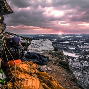 Cliff-side Sunrise by Matthew Robertson - Sports & Fitness Climbing ( climbing, winter, rope, snow, sleeping bag, sunrise, rocks, bivy )