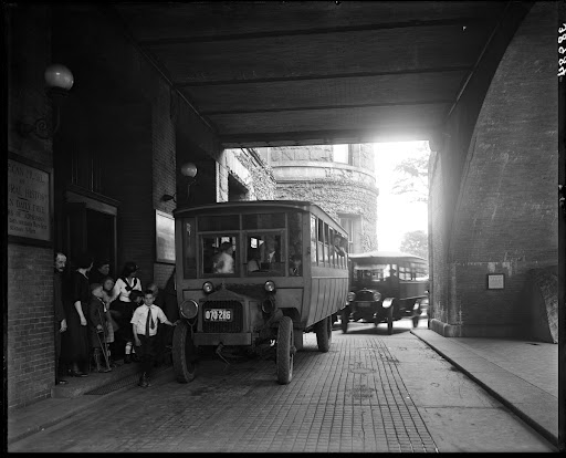 Children exiting Museum to school buses at the 77th Street Entrance, 1921
