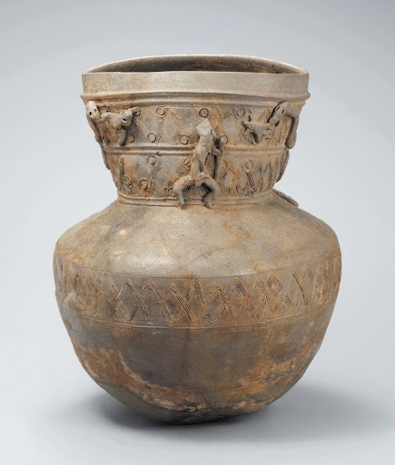 Long-necked Jar with Clay Figurines