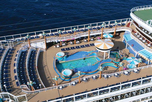 Norwegian-Dawn-Aerial-Pool-Deck - Swim, sunbathe and have a nice chat and some drinks with your pals on Norwegian Dawn's pool deck.