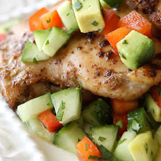 Spicy Chicken Thighs with Cucumber Avocado Salsa.