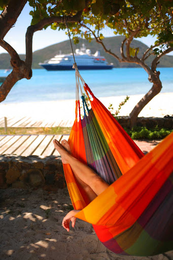 Want to relax? Sling yourself into a hammock during your SeaDream shore excursion.