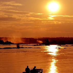 Sunset Zambezi by Matt Hulland - Landscapes Sunsets & Sunrises ( victoria falls, zambezi, africa, boat, river )