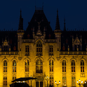 In Bruges by Arti Fakts - City,  Street & Park  Historic Districts ( city hall, rainy, carriage, horse, bruges, windows, yellow, artifakts, historic, night, historical, place, district, light, rain,  )