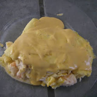 Seafood Omelets with Creamy Cheese Sauce.