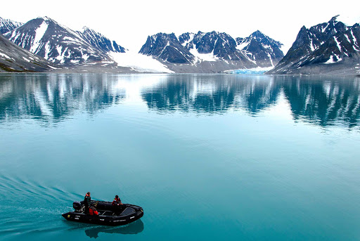 Arctic-Spitsbergen-Magdalena-Fjord-Mountain-Glacier-Zodiac - The majestic Magdalena Mountain Glacier in Spitsbergen in the Svalbard archipelago of Norway on G Adventures' ship Expedition.