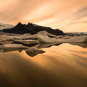 Fjallsárlón Glacier Lagoon by Naďa Murmakova - Landscapes Sunsets & Sunrises ( iceberg, berg, thermal, chilly, exploration, mass, sky, midnight, cold, nature, snow, arctic, frosty, climate, cool, lagoon, majestic, global, lake, glacier, iceland, winter, warming, floating, glacial, reflection, icecap, icy, block, ocean, afloat, frozen, atlantic, freezing, landscape, spring, mirror, tranquil, mountains, melting, froze, ice, iced, melt, water, polar, jokulsarlon, chilled, blue, freeze,  )