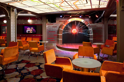 Allure-of-the-Seas-Comedy-Club - Remember when you used to go to comedy clubs? At Allure of the Seas' Comedy Live, headliners interact with audience members in a funky space resembling a New York City subway station.